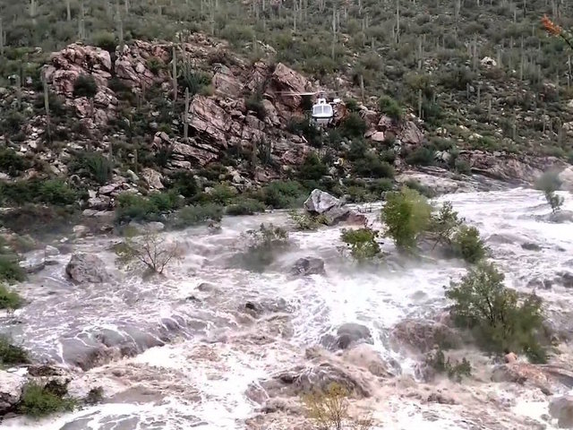 Rescuers work to save 17 hikers stranded in Arizona