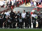 Dozens of NFL players kneel for anthem