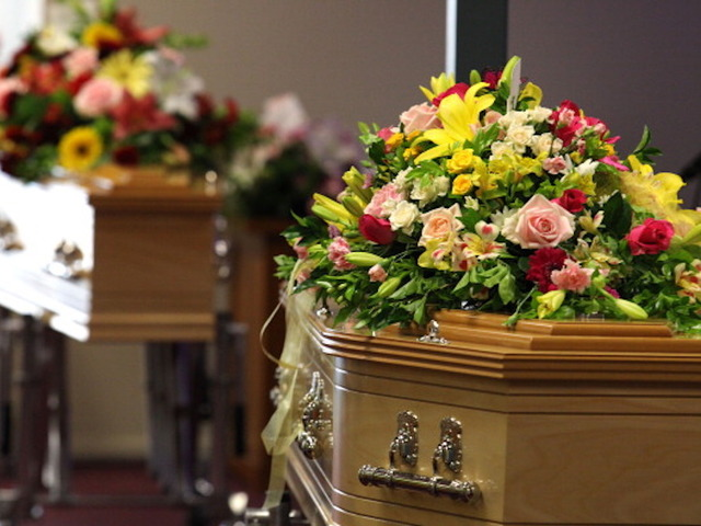 Gatton Australia January 20 Flowers Cover The Coffins At Funeral Of Noelene And Yvana Bischoff Baptist Church On