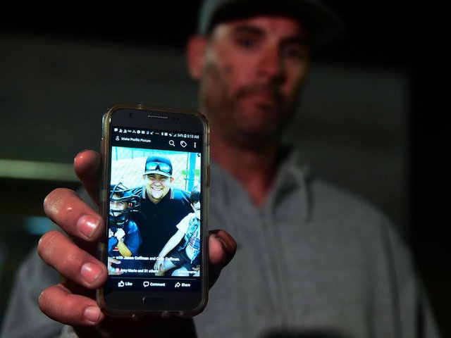Jason Coffman Displays A Photo Of His Son Cody Outside The Thousands Oaks Teen Center